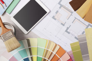 An interior design consultation with floor plans regarding remodeling & constructing a new home