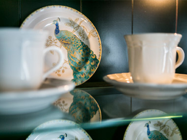 Dishes used to interior decorate a ding room hutch