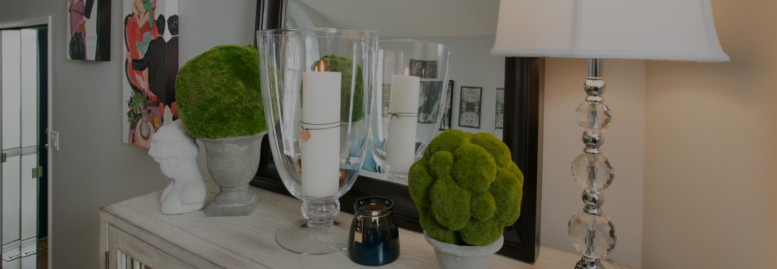 A dining room vignette decorated with candles