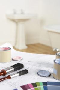 Interior decorating a bathroom by selecting a color through interior design elements.