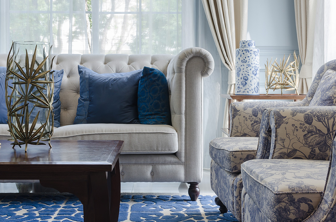 Close up image of furniture with blue accent pillows